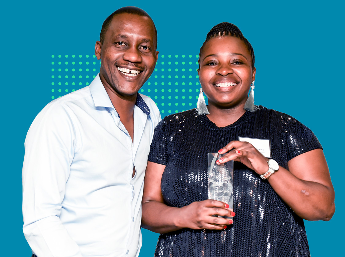 Black man and woman at an awards event